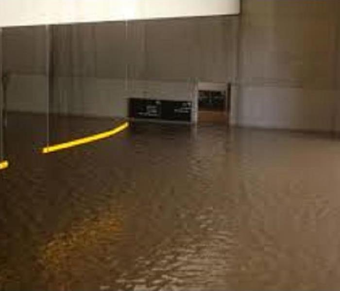 Flooded room with standing water.